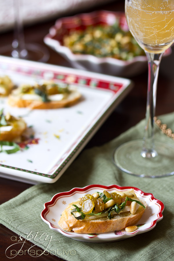 Brie Toasts Appetizer with Basil, Pine Nuts and Golden Raisins | ASpicyPerspective.com